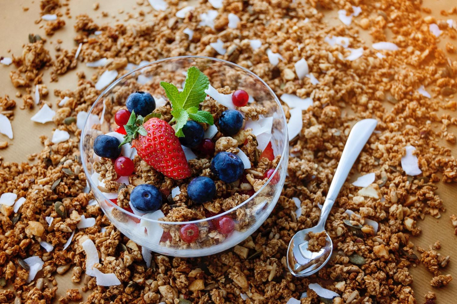 bowl of granola topped with fruit and coconut