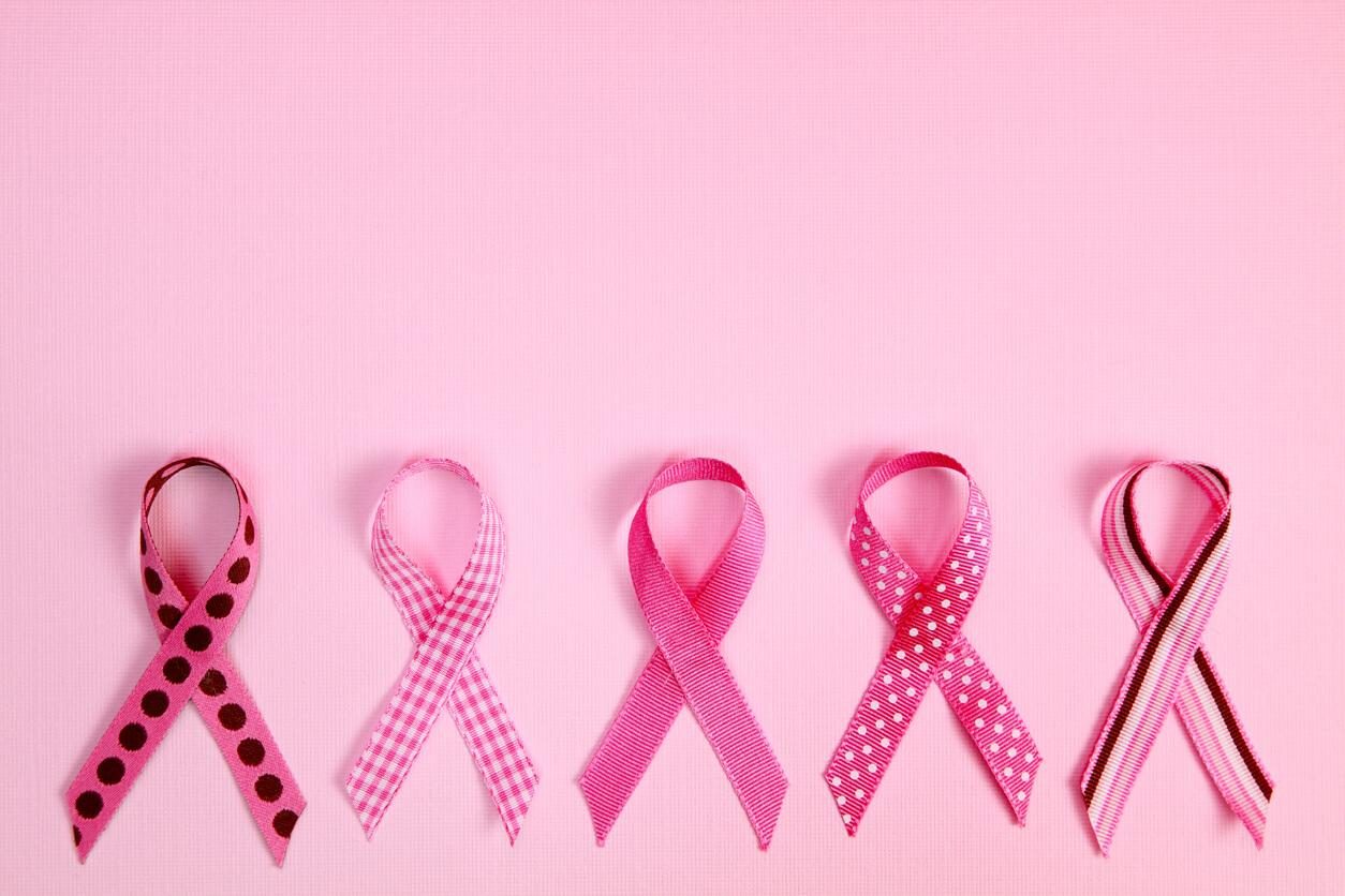 pink breast cancer ribbons on pink background