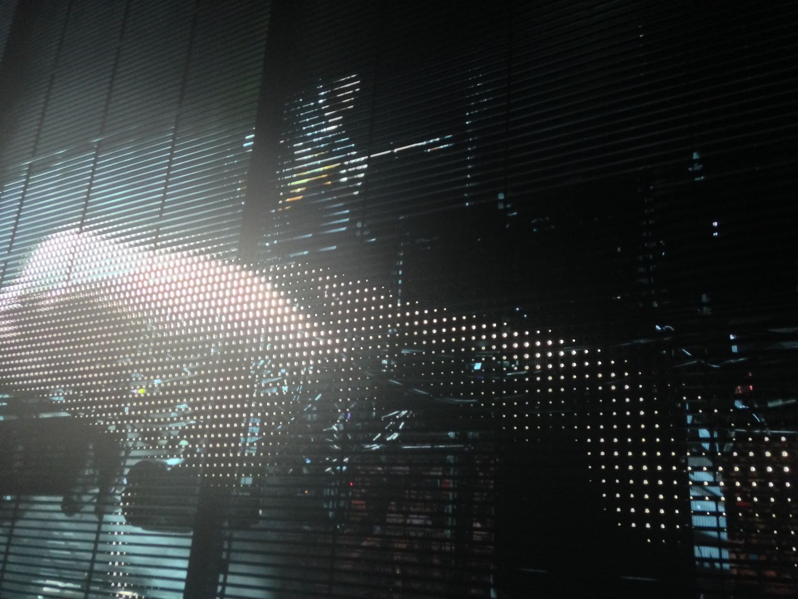 Bono's giant projector hand poking at Edge inside the screens