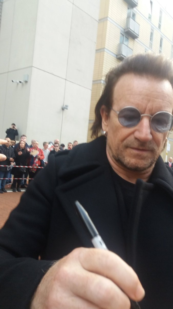 Bono signing my arm
