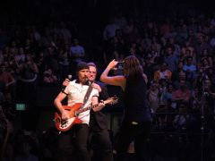 A fan captures the Edge and Bono at the Pepsi Center, Denver