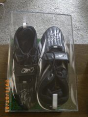 My Peyton Manning autographed game issued cleats
