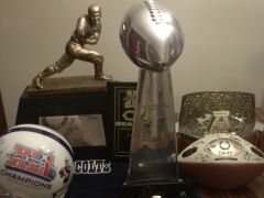 Heisman, Lombardi and retired AFC trophy