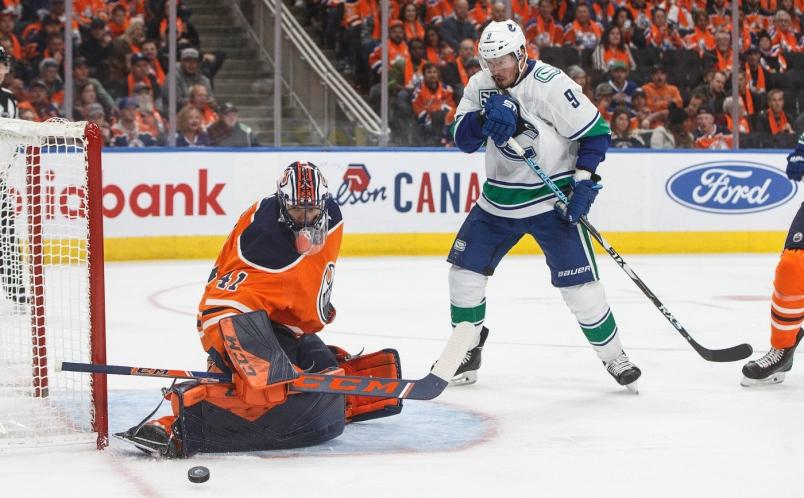 the-vancouver-canucks-j-t-miller-looks-on-as-mike-smith-of-the-edmonton-oilers-makes-a-save.jpg.2c7d836221c7b23b2687de42fd802979.jpg