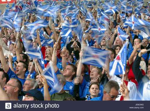 rangers-fans-with-flags-glasgow-rangers-fc-ibrox-stadium-glasgow-scotland-JE6CWG.jpg
