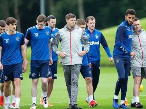 Bet the players feel 10 foot tall walking with a legend like Stevie G ).jpg