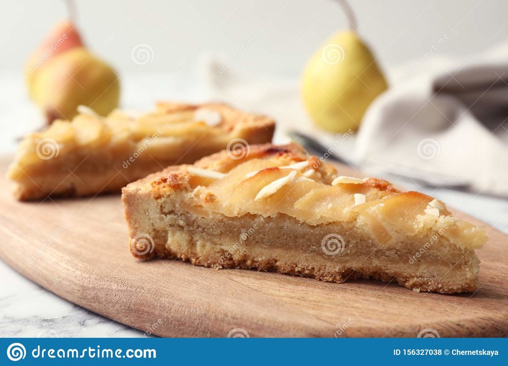 Board With Pieces Of Delicious Pear Tart On Table, Closeup Stock ...