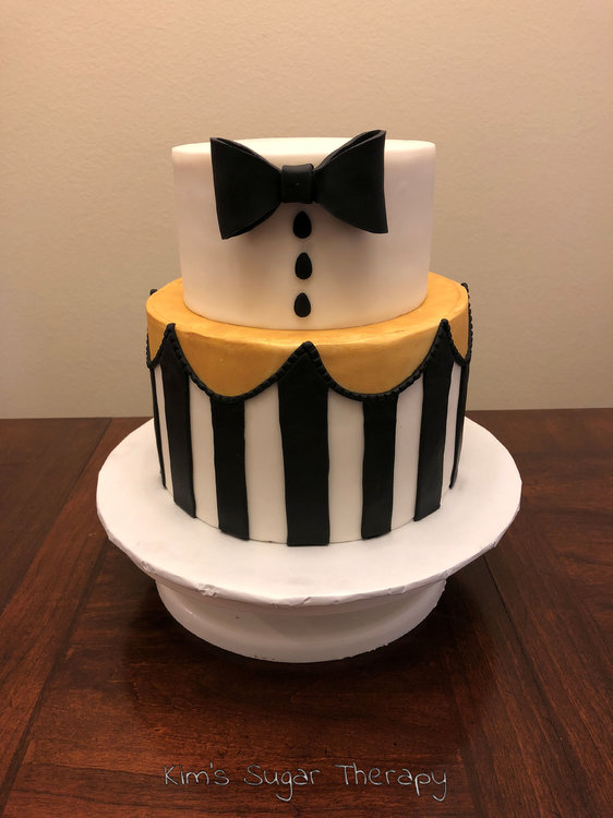 Bow-Tie-Cake-with-all-stripes.thumb.jpg.e329604442b9b45a20135914eddf3688.jpg