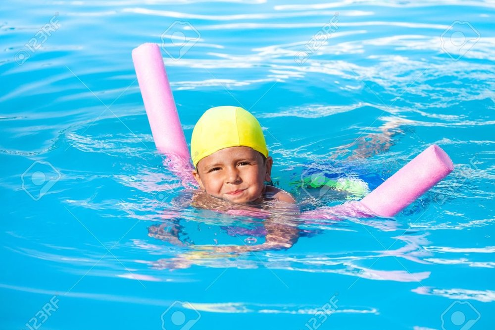 47251972-boy-learns-how-to-swim-with-pool-noodle-in-swimming-pool-during-summer.jpg