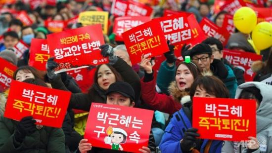 protesters-in-seoul-pictured-on-december-24-2016-attending-a.jpg