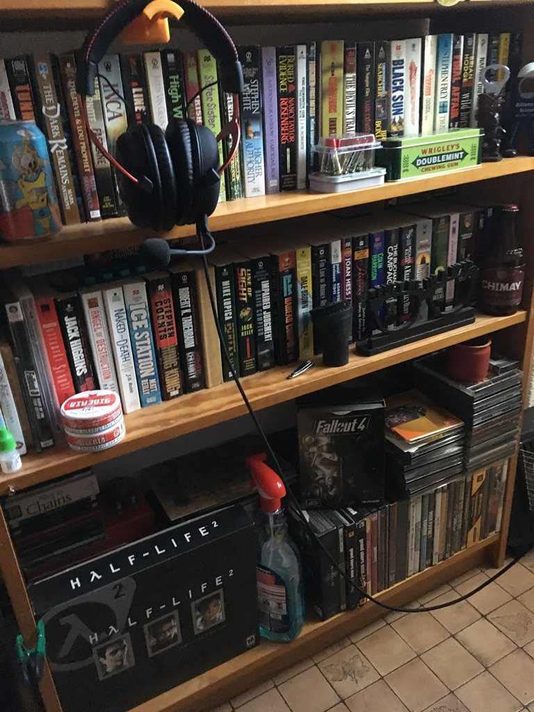 bookshelf to the left bottom game collection