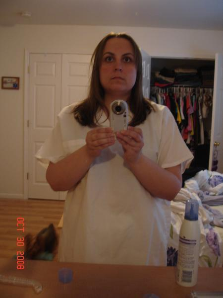 Posing for the camera.  Happy to be 166.9!!!  Down 60.1lbs.  Size XL or L in some tops, and a 12 in jeans and 10 in dress pants.  Here I'm in my Halloween costume.  I'm a nurse.  Boring, I know!  LOL