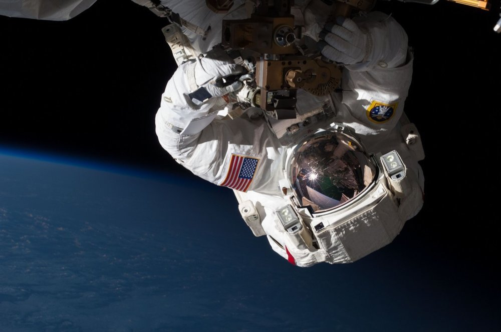 heres-another-astronaut-repairing-the-space-station-during-a-space-walk-you-can-see-the-earth-is-relatively-dark-in-the-background.jpg