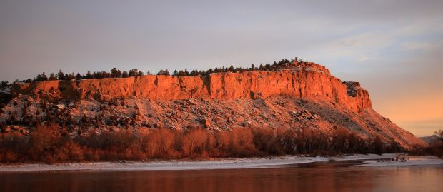 Sacrifice Cliff glows at sunset Wednesday, December 17, 2014..jpg