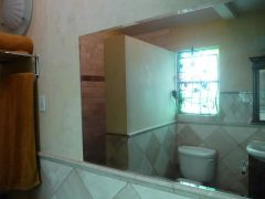 The stained glass and metal grate, i also tiled the bathroom