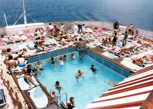 Mardi Gras pool area and open decks, August 1984.jpg