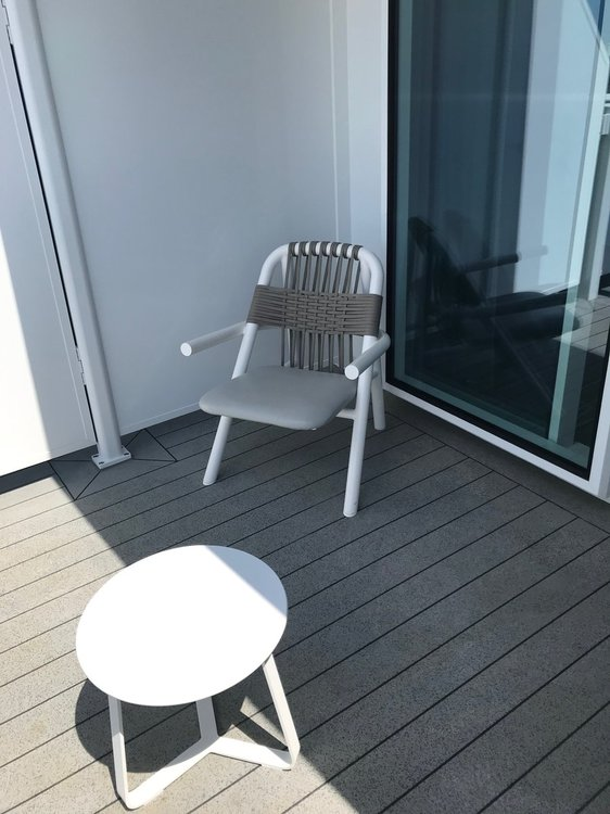 Celebrity Edge little chair and table on veranda.jpg