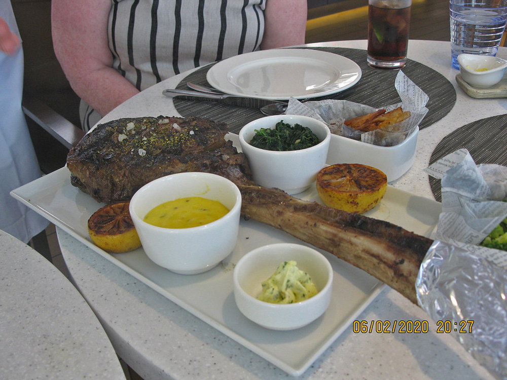 Our cooked Tomahawk steak.jpg