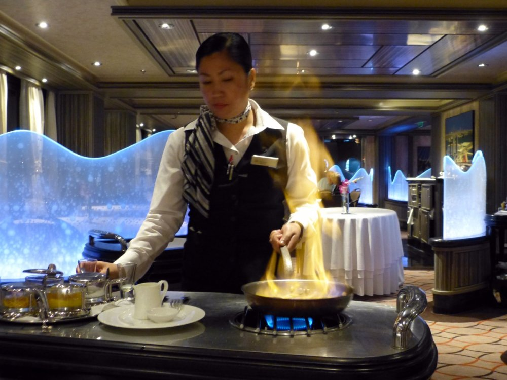 1349 Waitress preparing the Crepes Epicurean Restaurant Azura - Iberian Cruise 2015.jpg