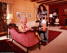 Grace Slick with parent and upside down baby