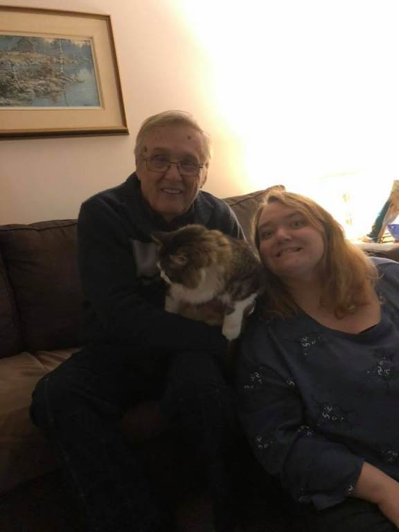 A family portrait, of a papa, a Kylene, and a very  much so disinterested Lindy Lou <3