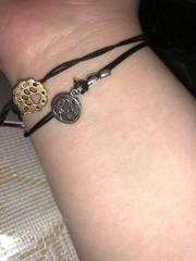 Two Alex and Ani bracelets. One: a cat meaning unconditional love from Lins <3 The second? A paw print also saying unconditional love, but from pets :)
