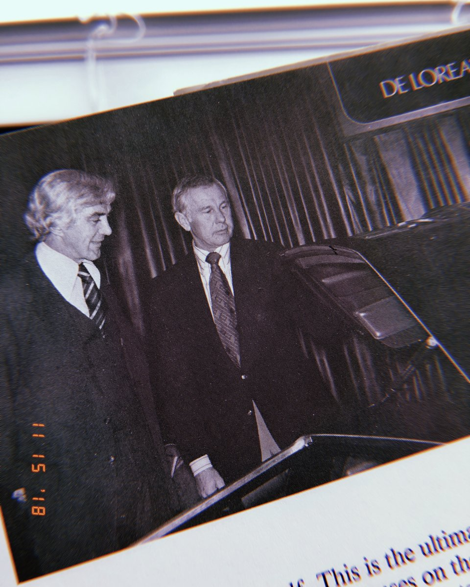 John Z. De Lorean showing first completed prototype to early DMC investor Johnny Carson