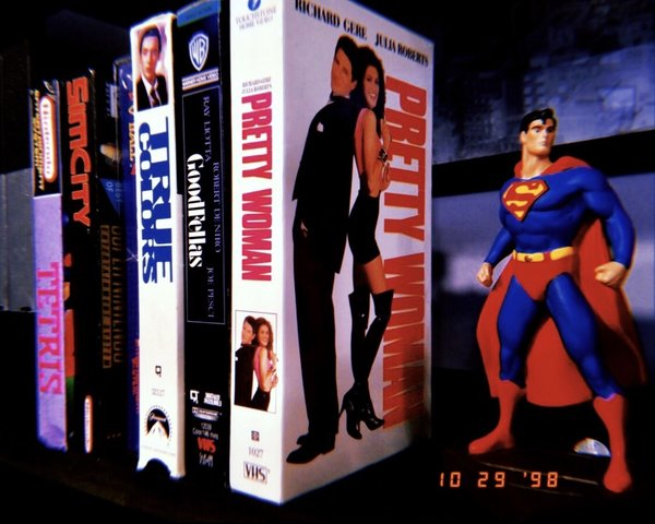 Seinfield '90s Living Room VHS Tapes & Superman