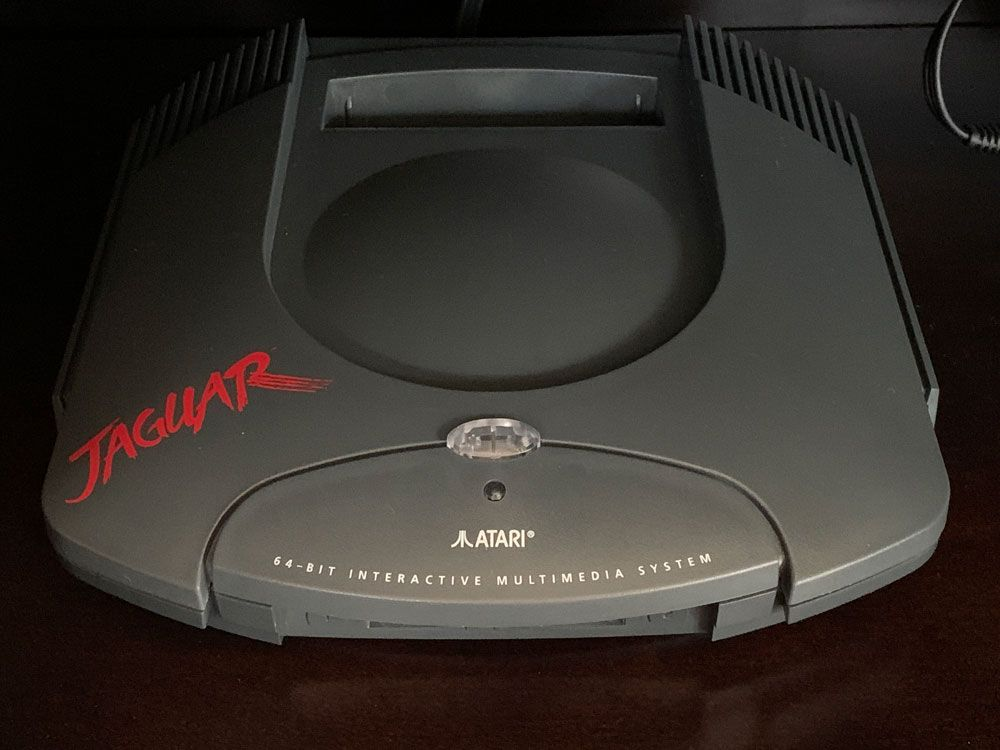 handome_atari_jaguar_clear_button_1.jpg