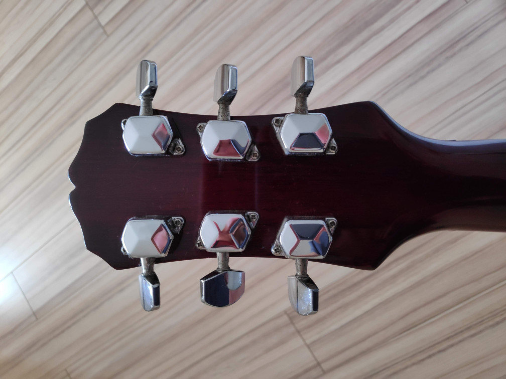 i d  your Epiphone here -- serial # key, guitardater link +