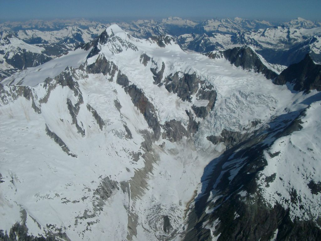 Selkirk Mountains fore, Purcell Mountains mid, Rockies distant.