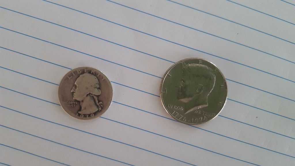 Fifty cent coin along with silver quarter