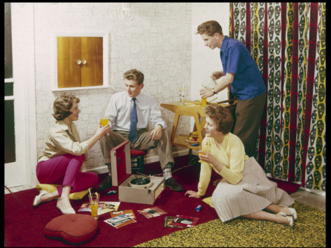 four-smartly-dressed-teenagers-having-cocktails-around-a-record-player.jpg