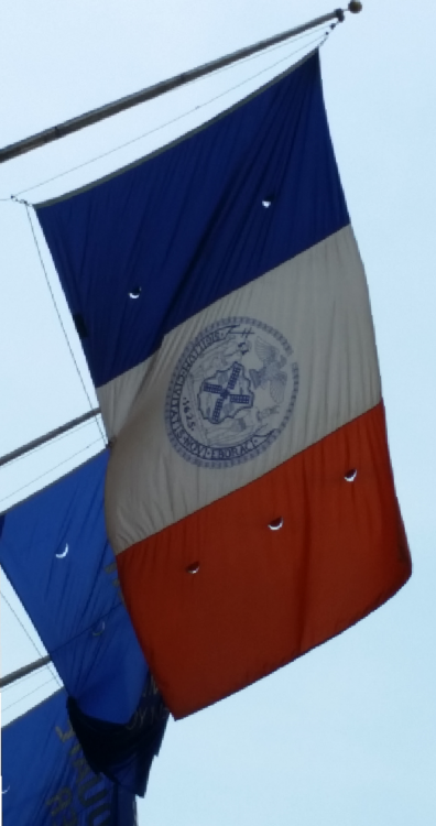 NYC flag with motto.png