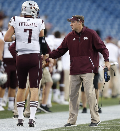 9562108-dan-mullen-nick-fitzgerald-ncaa-football-mississippi-state-massachusetts.jpg