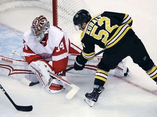 636414513790213188-AP-Red-Wings-Bruins-Hockey-M-2-.jpg.ea13152e3d92e907b9f5bd56f02b98ec.jpg