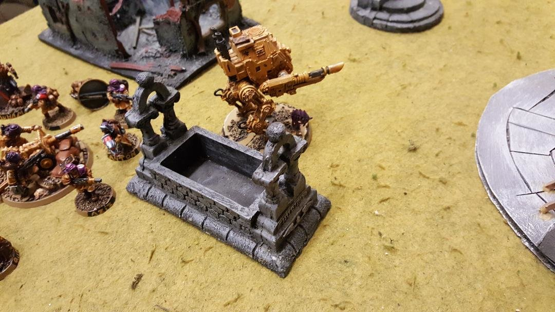 4 Tallarn armored sentinel moves up with infantry squad in support.jpg
