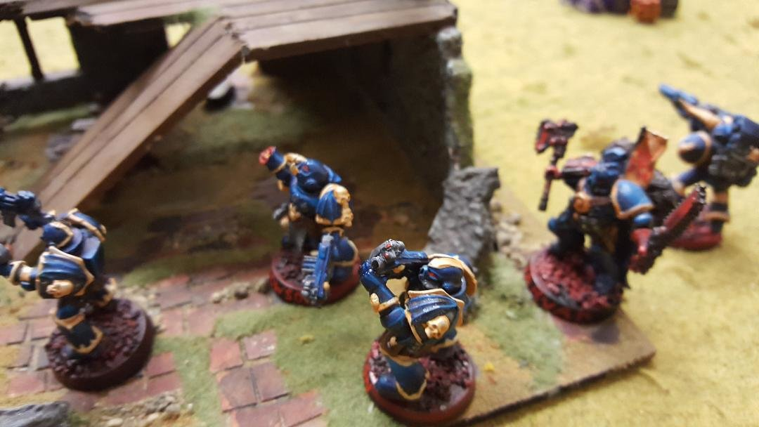 14 Chaos Marines Death Bats Squad moves into the ruins.jpg