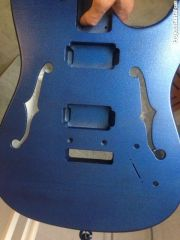 Metallic blue on black base coat, sanded and finally applied a semigloss clear coat