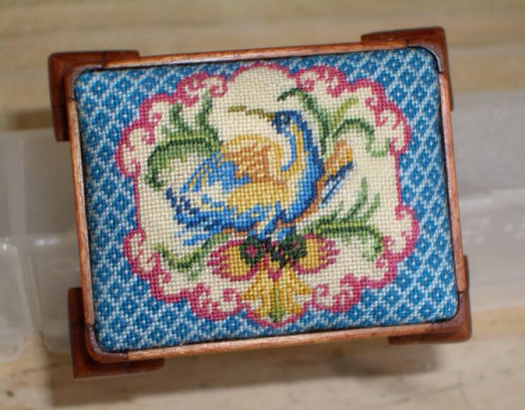 Footstool cover by Corky Anderson