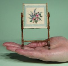 A needlework stand design called 'Larkspur and Roses' by Janet Granger