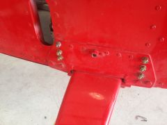 Landing gear bolts for rivets.  Side view, six new bolts perpendicular to fuselage