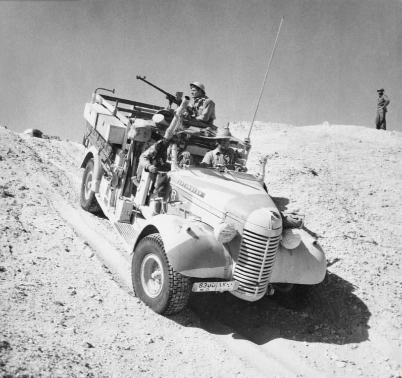 5ac8344c5a34a_A_Long_Range_Desert_Group_Chevrolet_30cwt_1533_truck_negotiates_the_slope_of_a_sand_dune_during_a_patrol_in_the_desert_27_March_1941._E2298.thumb.jpg.06a82d9b0c933ec97a209a77d044138e.jpg