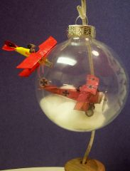 Paper planes in and out of an ornament