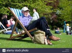 older-man-sleeping-on-a-deckchair-in-park-bath-england-C5R28Y.jpg