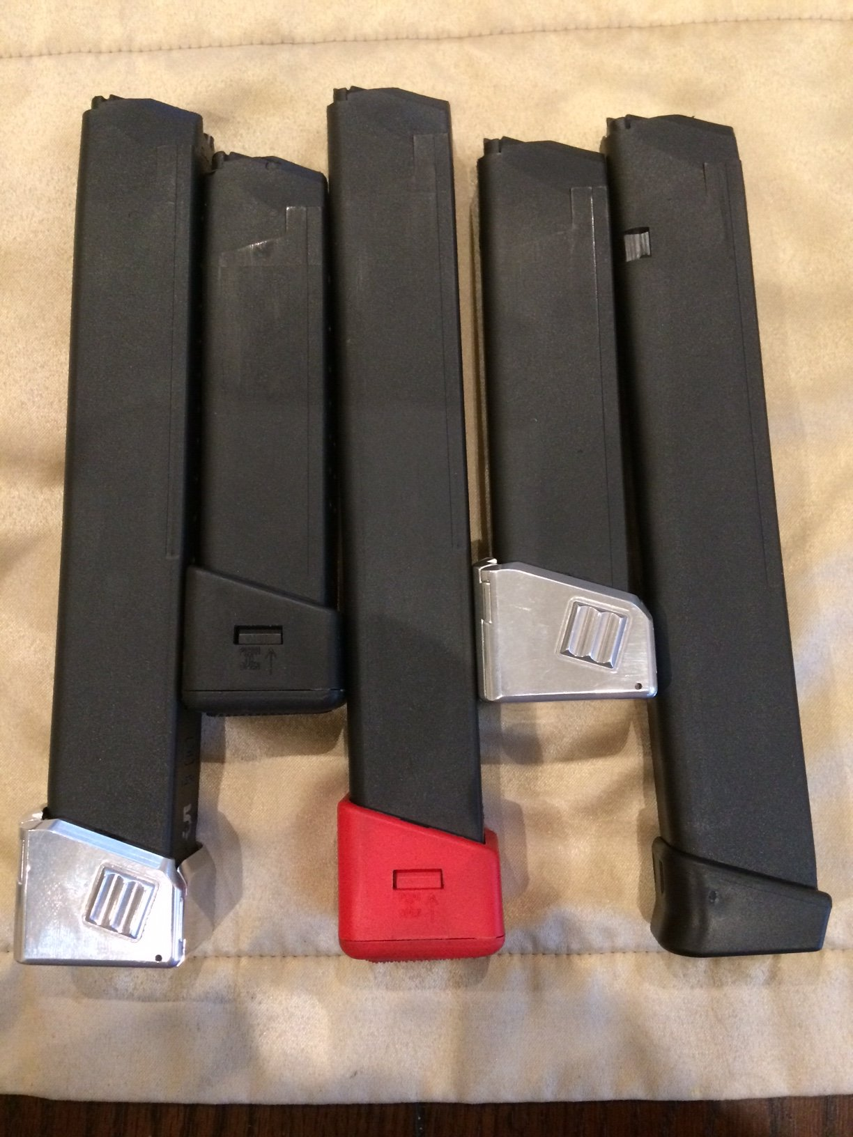 glock 33 round magazines and extended base pad pistol caliber