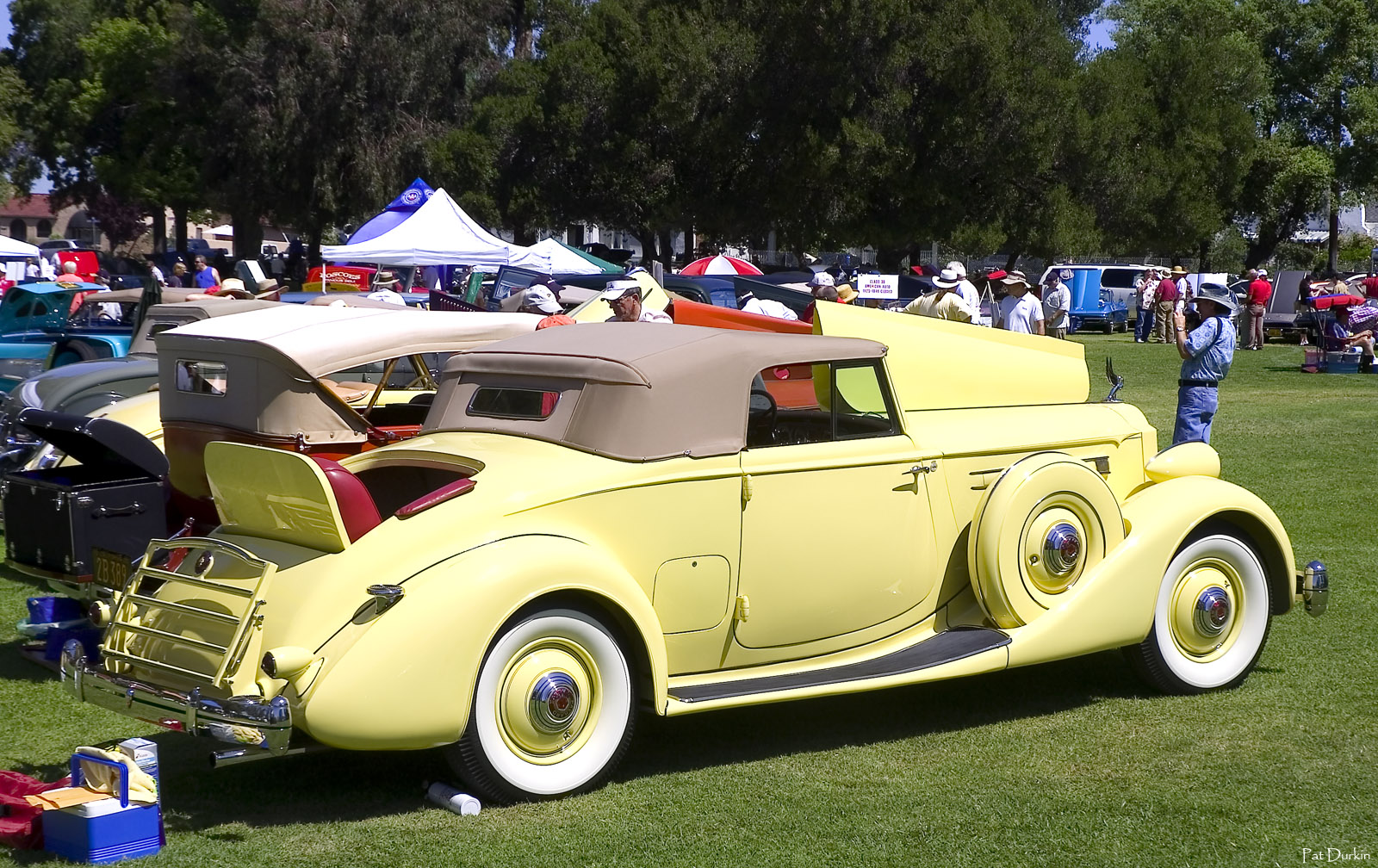 1935 Packard 1207 Convertible Coupe with top up - yellow - rvr