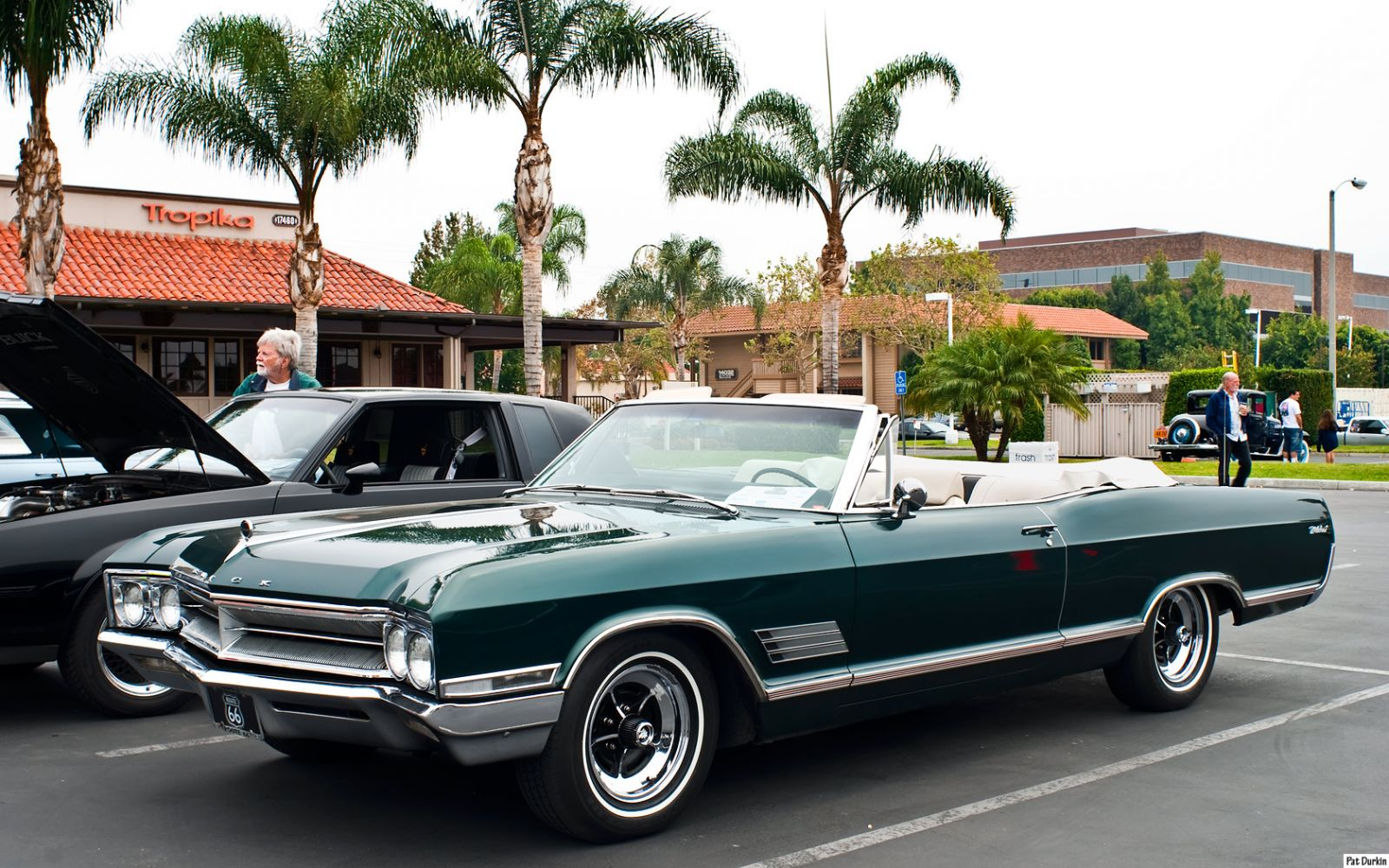 1966 Buick Wildcat convertible with top down - dark green metallic - fvl