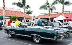 1966 Buick Wildcat convertible with top down - dark green metallic - rvl