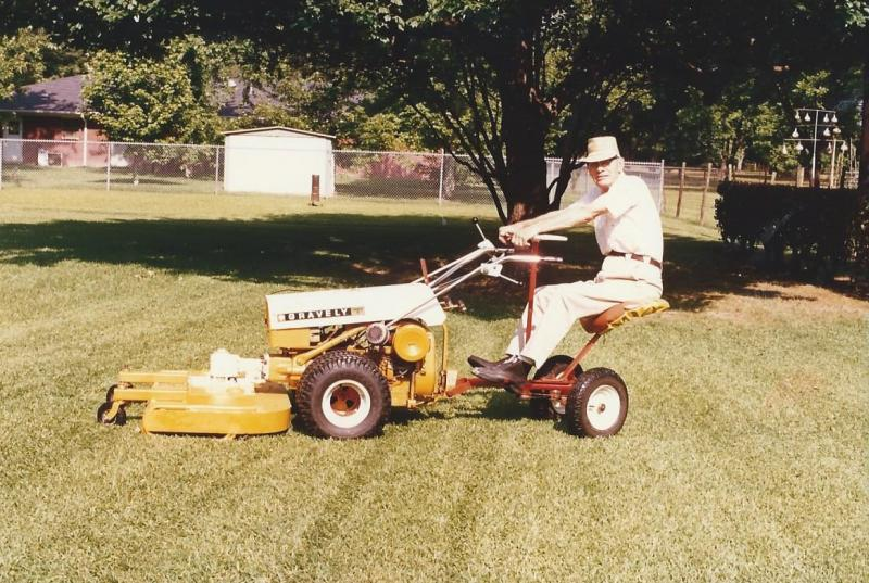 Robert Morris Smith on Gravely tractor-mower, 7th St N, Columbus, MS, ca1975.jpg